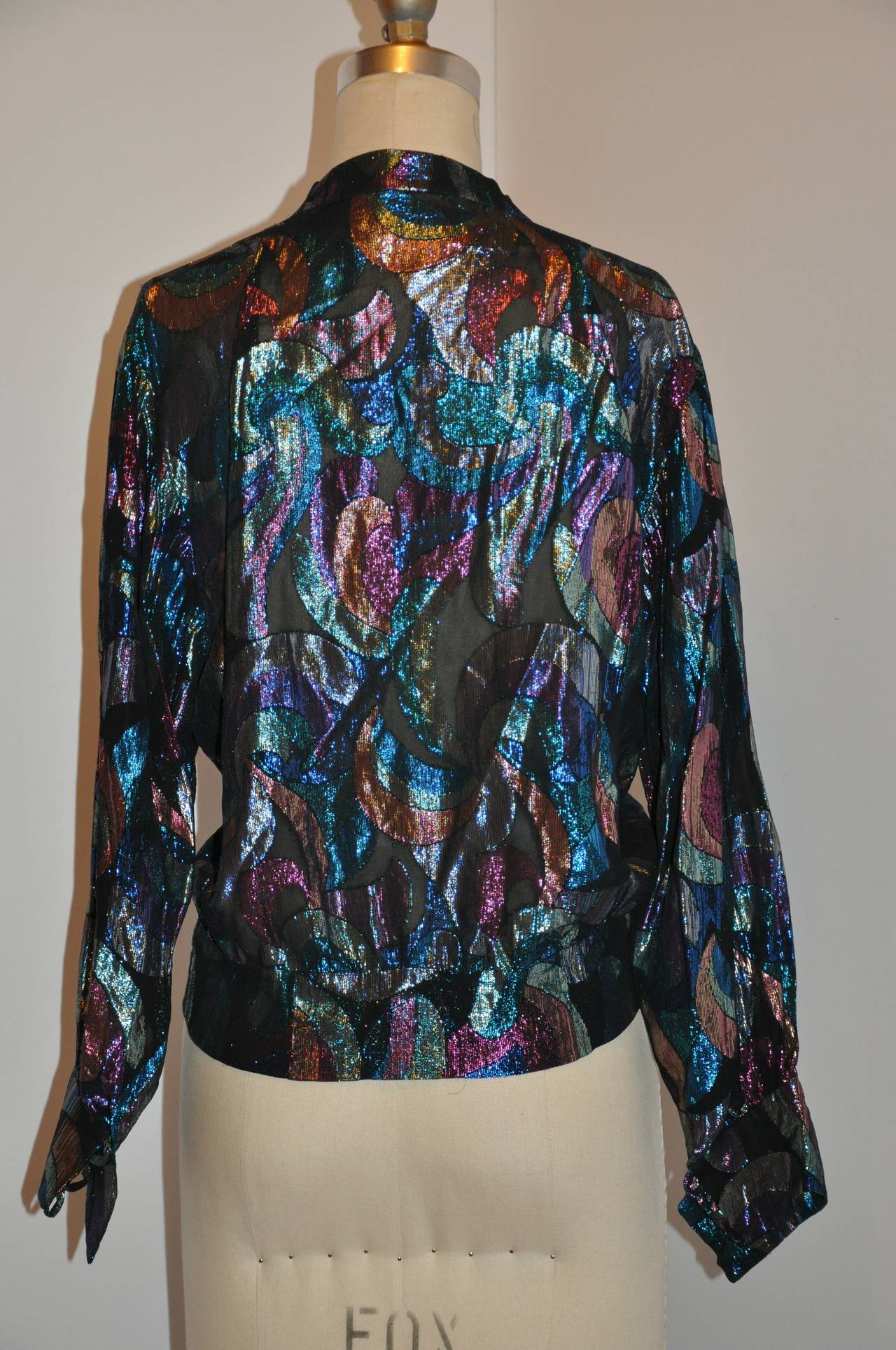 This wonderfully detailed combination of black silk chiffon blended with multi-colors of turquoise, red, tangerine, peach, silver and gold metallic threads makes for a wonderful evening top. feather-weight when wearing, the mandarin collar measures