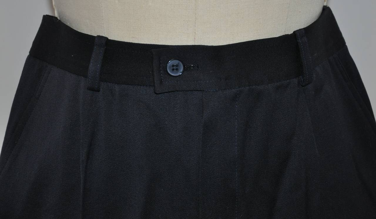 "Yves Saint Laurent navy wool signature gabardine trouser measures 29"" at the waist. The waistband is 1 1/2"" in width, hips are 40"", inner leg length is 31 1/4"", outer leg length is 42 1/4"", crotch-to-waist in front is 13 3/4"", back is 15 1/8""."