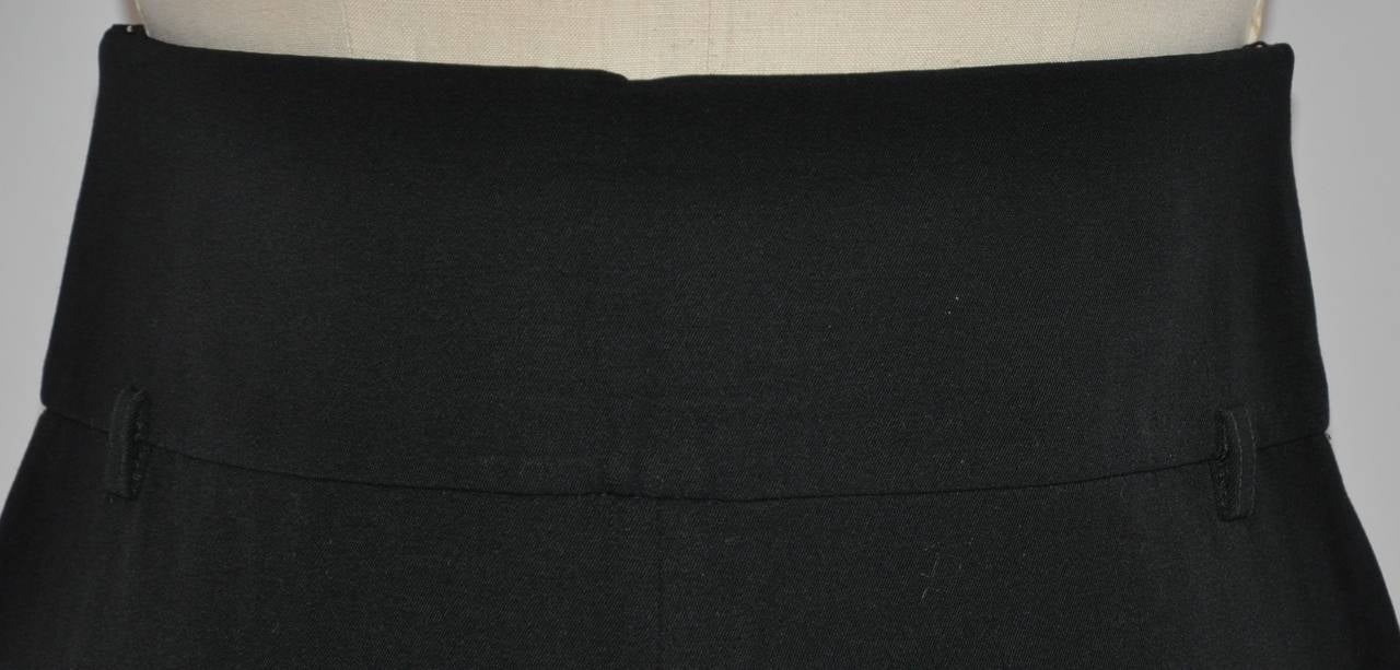 "Yves Saint Laurent signature black wool gabardine high-waisted trousers measures 29"" at the waist, waistband measures 3 1/4"" in width, hips are 38"", inner leg length is 33 1/8"", outer leg length is 46"", hem circumference is 23 1/2"" with 1 1/2"" to"