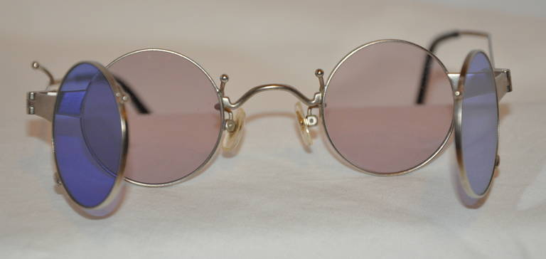 """This wonderfully well-made double-lens eyeglasses and sunglasses has the option to flip-out the tinted purple lens for the use of the eyeglasses when needed. The front measures 5 1/8"""" across the front, arms are 5 1/2"""" and the height is 1 1/2""""."""