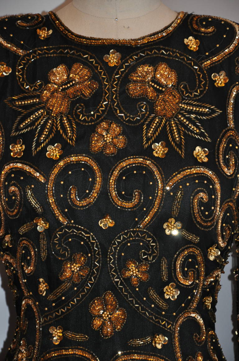 Lawrence Kazar wonderfully elegant fully lined black evening top is accented with detailed gold sequins, micro seed glass beads, gilded gold micro balls along with bugle glass beads and highlighted with a scallop hemline.