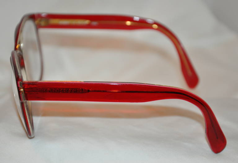 5bbcfa319b27 Robert La Roche thick red lucite glasses has a gilded gold hardware frame  within detailed with