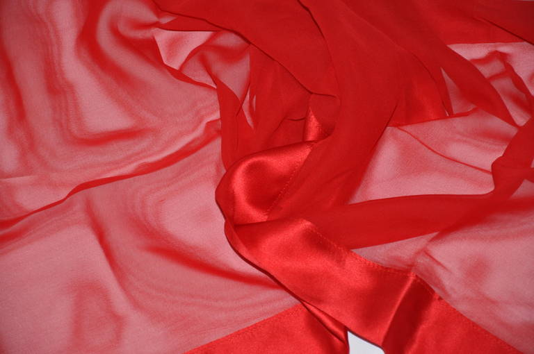 This wonderful large bold red chiffon scarf is accented with a double-layer of silk crepe de chine of the same bold red measuring 2 1/4 in width. The scarf measures 60