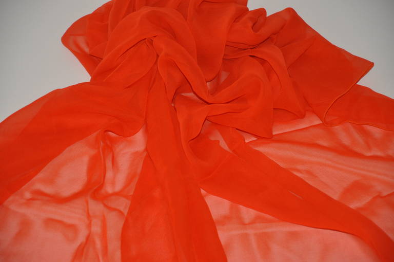 This large bold tangerine silk chiffon scarf measures 93