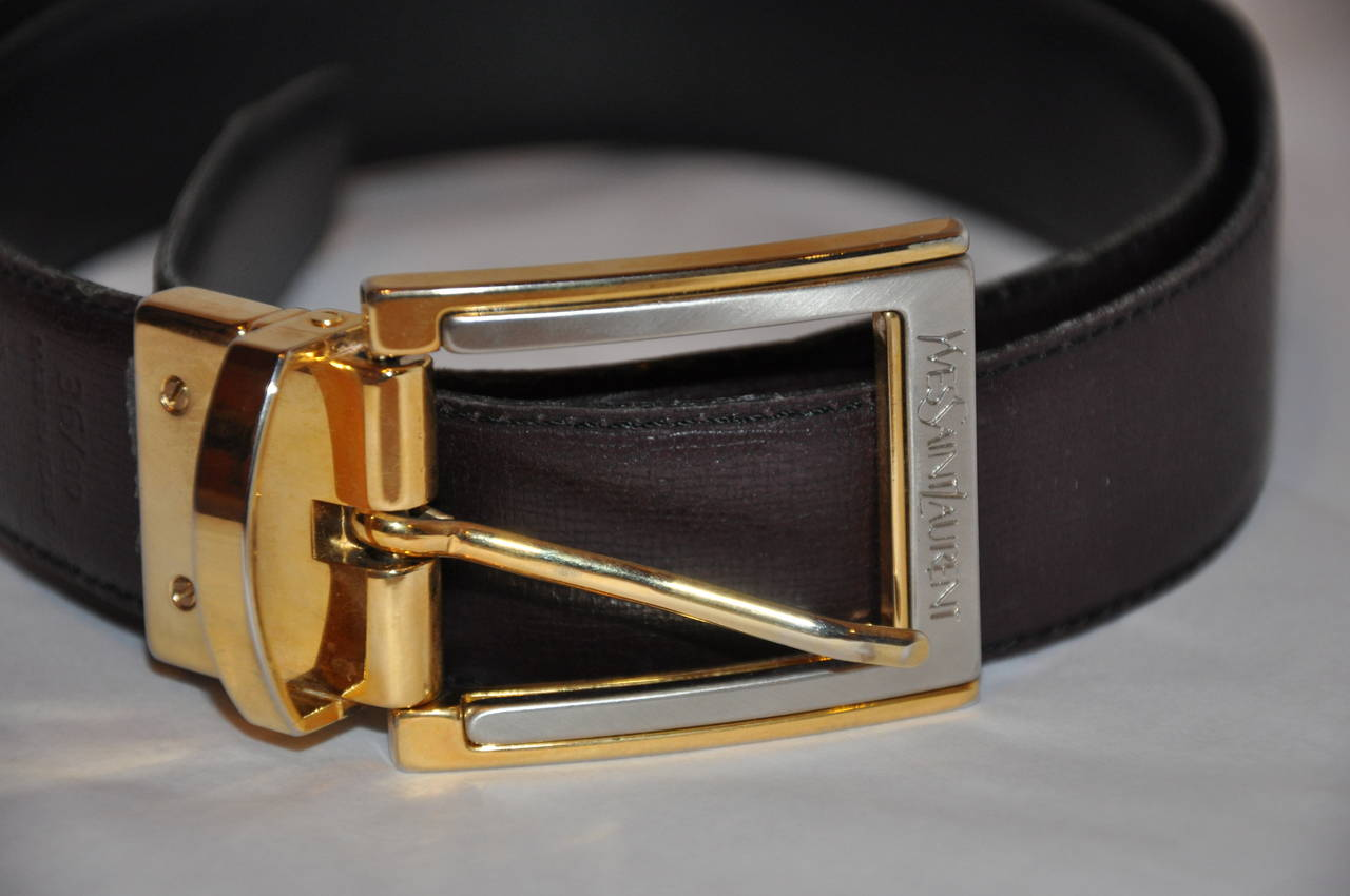 Yves Saint Laurent men's reversible calfskin with gold hardware belt has the choice of either a black calfskin or a brown calfskin to match the signature gold hardware with Yves Saint Laurent signature name etch onto the hardware.