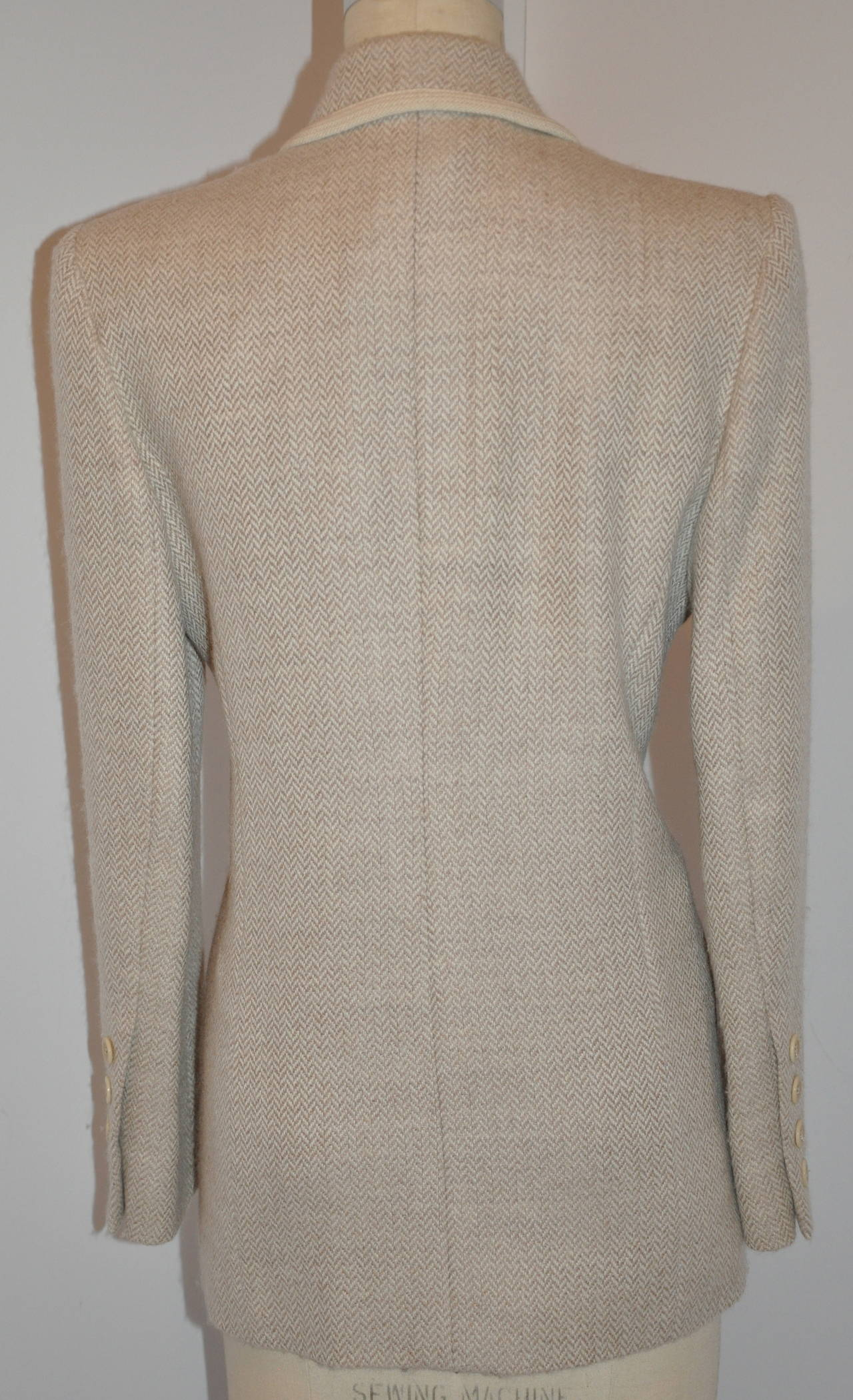 Ines de la Fressange wonderful blend of lambwool and angora in shades of creams is sized 40/French.    The shoulders measures 16