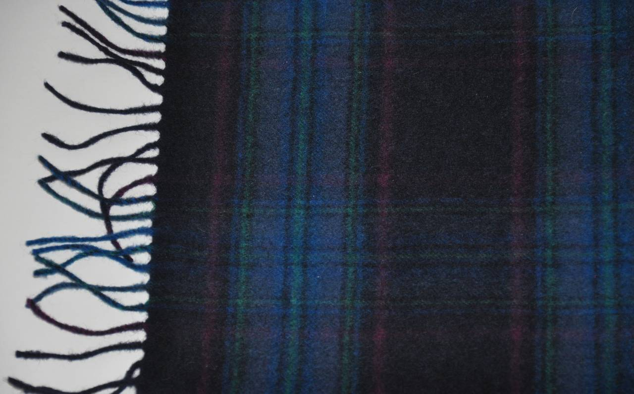 "This wonderful Harrods multi-color plaid with fringe scarf from Scotland is blended with 60% cashmere, 40% wool. The scarf measures 12 1/2"" x 59"". Made in Scotland."