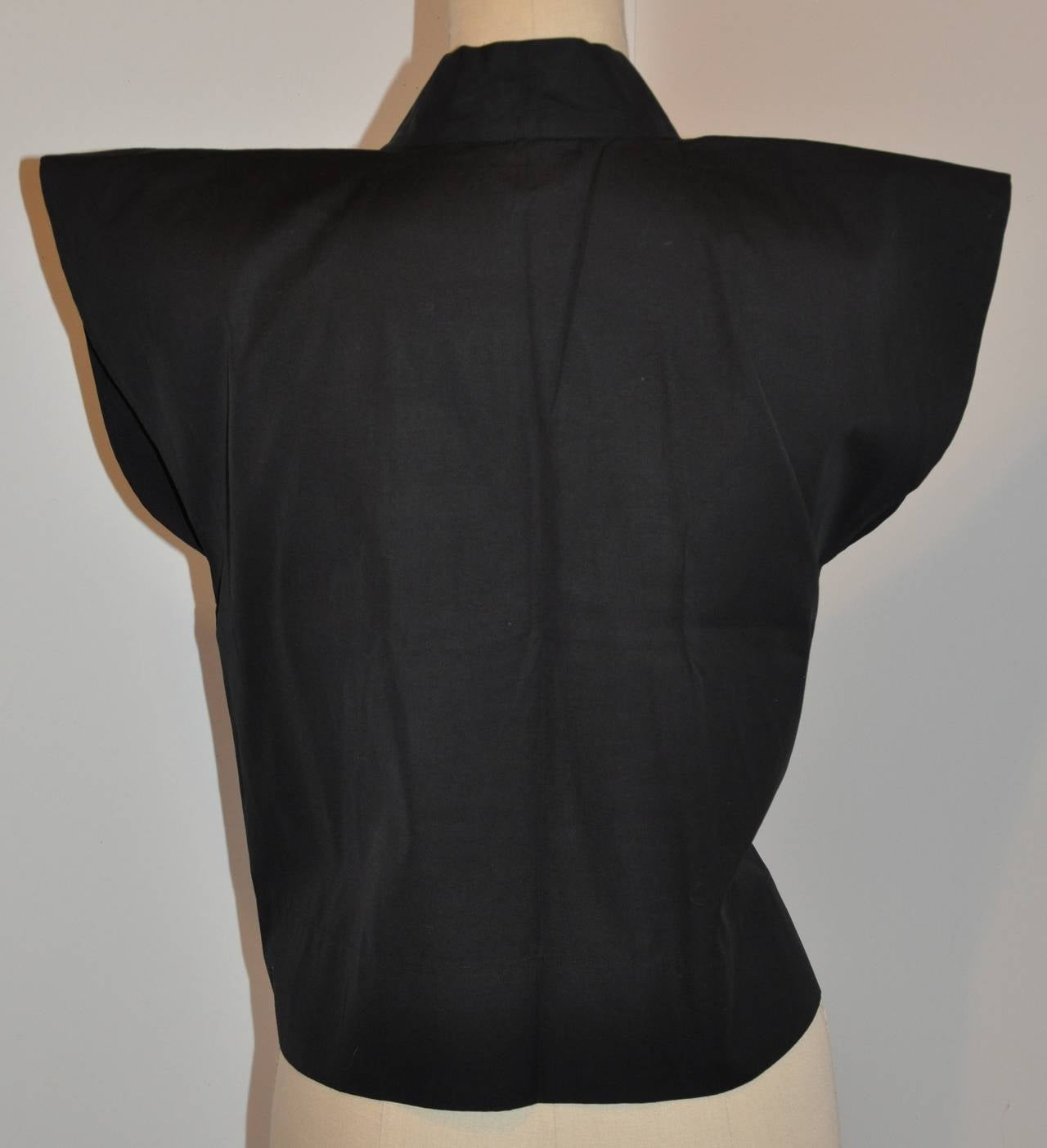 """Agnes B' 100% cotton black kimino style warp top measures 19 1/2"""" in total length. The shoulders are 6 1/2"""" with the arm circumference measuring 19 1/2"""", underarm circumference is 40"""". Sized 3/French."""