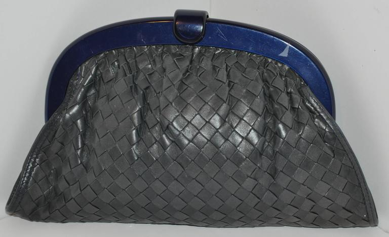 """Bottega Veneta """"Shades of gray & Black"""" signature woven lambskin clutch measures 9"""" in length along the top and 12"""" along the bottom. The height measures 7"""" with a depth of 3 1/2"""". Frame is of lucite. The interior is fully lined with their"""