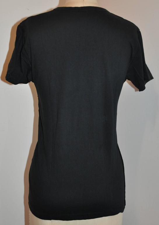 Sonia Rykiel whimsical black cotton tee is detailed with multi-color embroidery in front. The length of the front measures 21