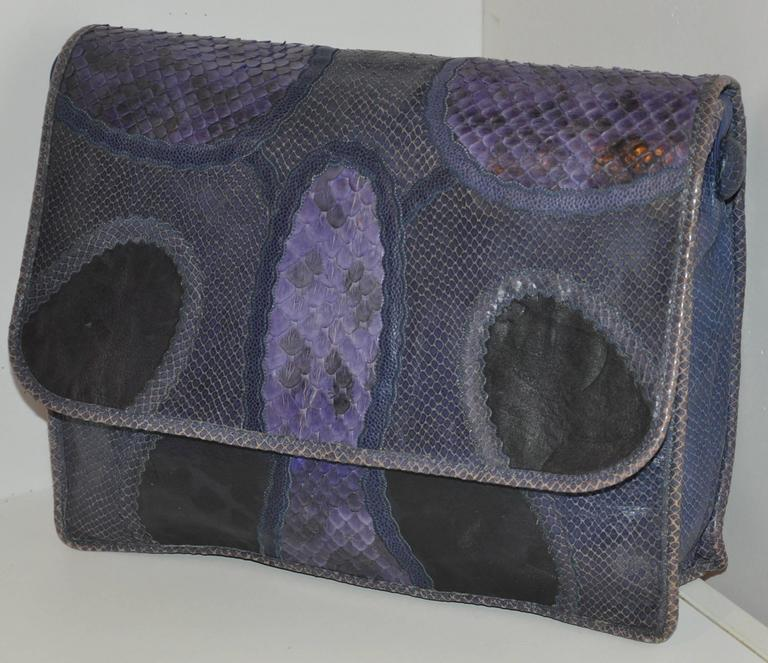 This wonderfully rare Carlos Falchi large shoulder bag with the option to wear use as a clutch is combined with multi-skins of snakeskin, lizard skin and pylon skins as well as textured calfskin. This wonderful shoulder bag in in