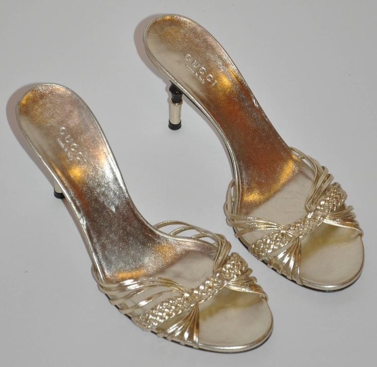 Gucci's wonderfully elegant and sexy metallic gold lambskin sandal with accented with