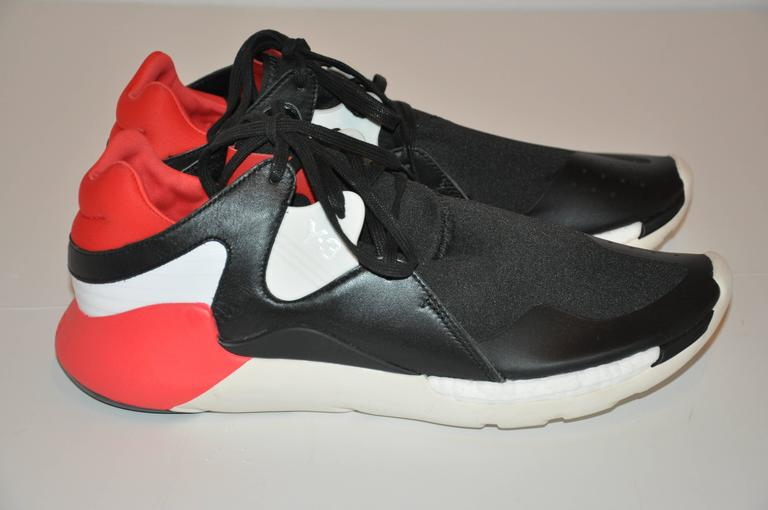 Yohji Yamamoto men's multi-colors of black, white and accented with bold neon red with lace-up rubber sneakers measures 12 1/2