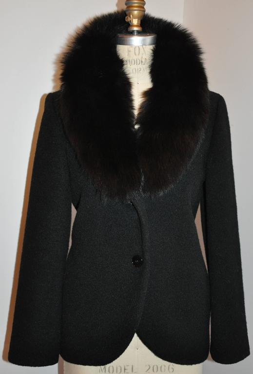 "Pierre Cardin ""Boutique"" wonderful elegant fully lined black wool accented with a black fox collar has two buttons in front. The fox collar has the option to stand up if desired for those chilly evenings. The bodice is slightly flared with a"