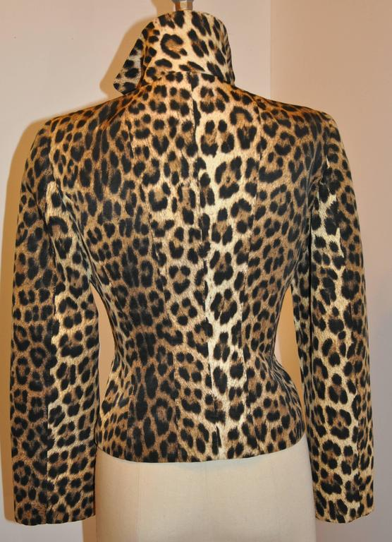 Moschino for Bergdorf Goodman wonderfully wicked leopard print button jacket is fully lined. The front has five buttons as well as two set-in pockets and flaps for a more polished elegant appearance. Made of 60% cotton and 40% rayon, the