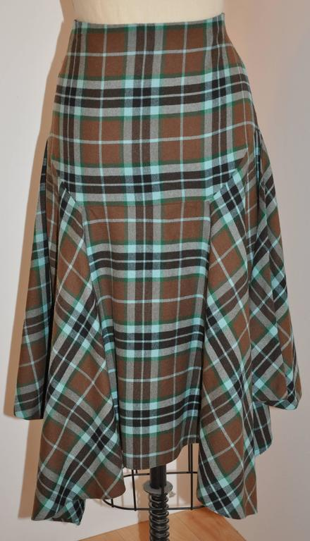Givenchy wonderfully detailed multi-colored plaid deconstructed skirt has a side invisible zipper which measures 7