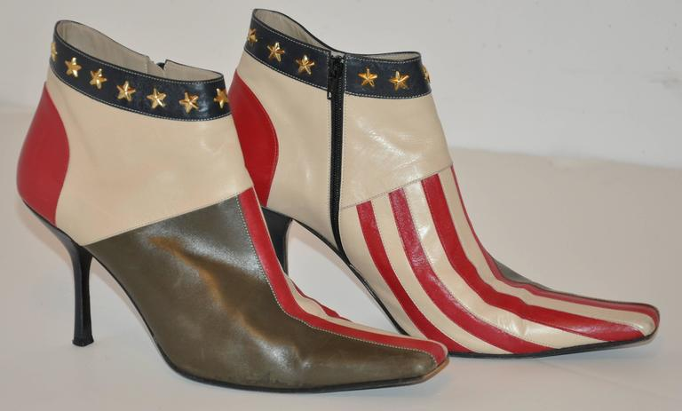 "Moschino wonderfully wicked ""Stars & Stripes"" calfskin side zippered ankle boots are accented with gold hardware studded ""stars"" along the top circumference. The side zipper measures 5 1/2"" in length, ankle-top circumference is 10 1/4"", and"