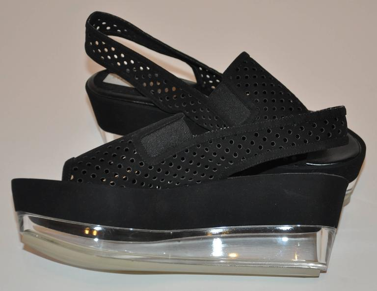 Stella McCartney clear lucite-base platform black open-toe front sling-back sandals is accented with two side elastic along the front sides. The height of the platform in front measures 1 7/8