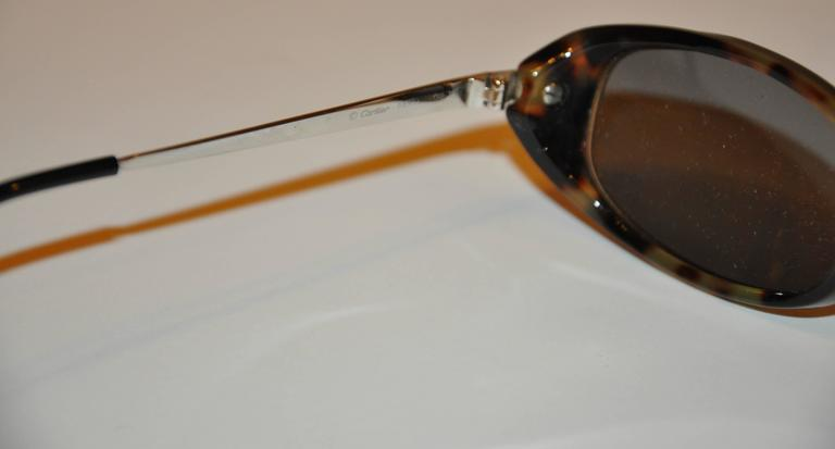 Women's or Men's Cartier Tortoise Shell Accented with Silver Hardware Sunglasses For Sale