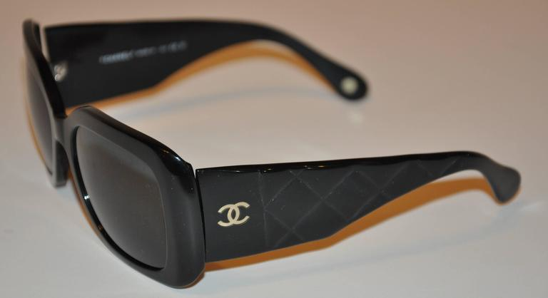 Chanel large thick black lucite sunglasses are accented with