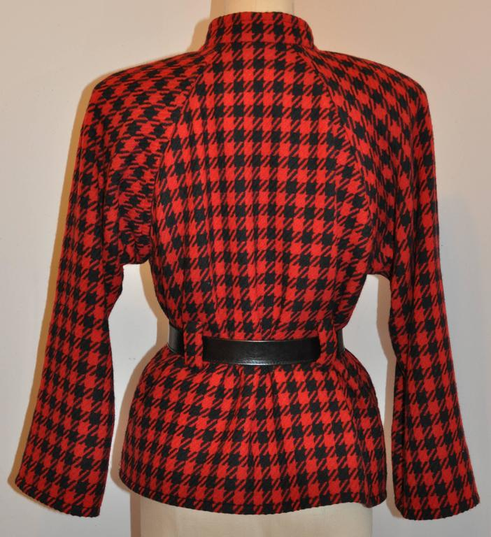 Yves Saint Laurent wonderfully tailored black & red jacket gives the option of wearing with or without a belt. (Belt shown in photo is not included).  Fully lined with black silk, this five-button front jacket measures 18
