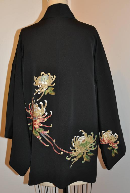 This wonderful fully hand-sewn Japanese black silk kimono jacket is detailed with hand-braided cord on the interior which is lined with prints of