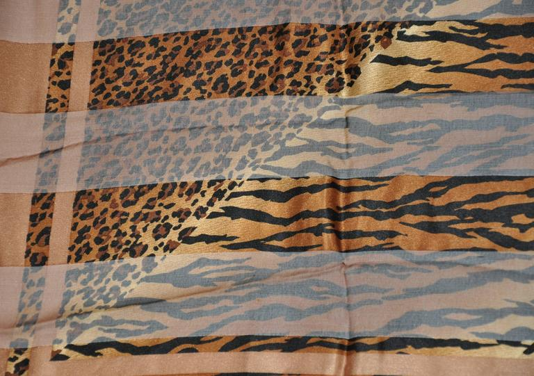 "Adrienne Vittadini ""multi-size leopard print"" combination of silk and silk chiffon scarf measures 34"" x 34"". Made in Italy."
