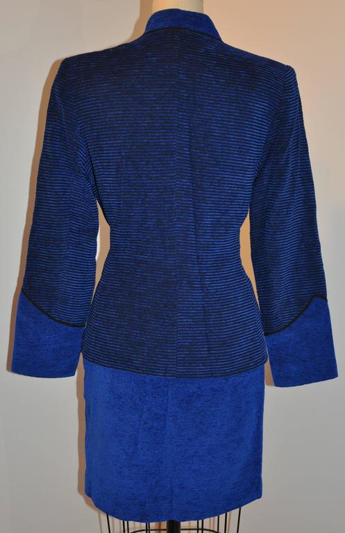 Yves Saint Laurent wonderful combination of Lapis blue accented with black skirt and matching jacket emsemble accented with a mandarin collar which measures 1 1/2
