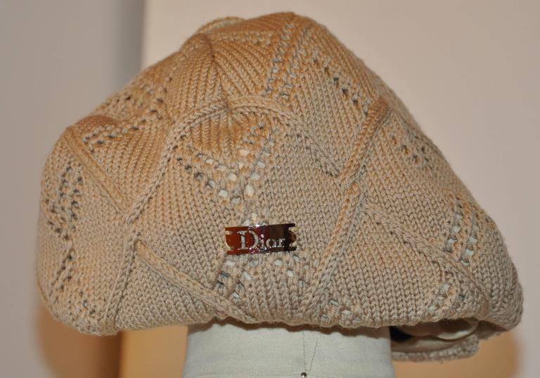 """Christian Dior """"Boutique"""" fully-lined woven beige """"Newsboy"""" cap measures 23"""" in circumference on the interior. Fully-lined and accented with a 1"""" ribbon cord around the interior edge, the front extends 2 1/2"""", and"""