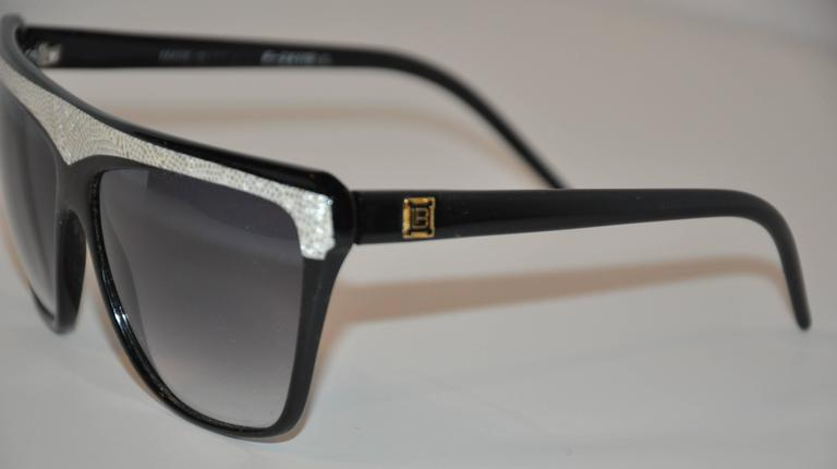 """Laura Biagiotti wonderful combination of black lucid frames accented with gray & cream """"snake"""" lucid on top of the frames measures 6"""" in width, 2 7/16"""" in height, and 5 1/2"""" in length on the arms. The arms are accented"""