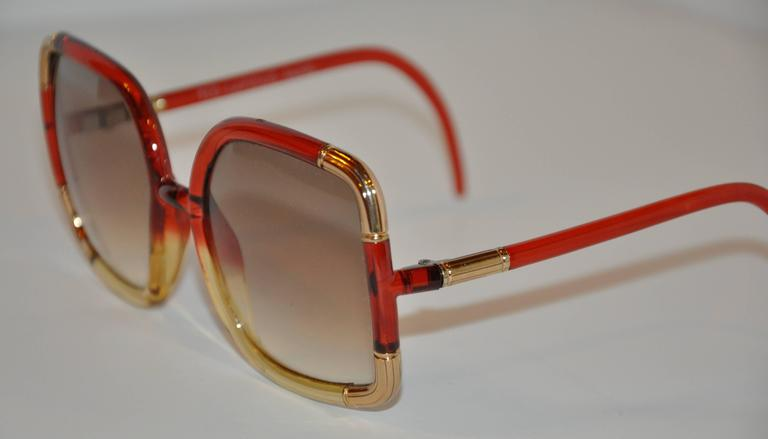 Ted Lapidus wonderful combination of red and gold lucid is accented with detailed engraved gold-tone