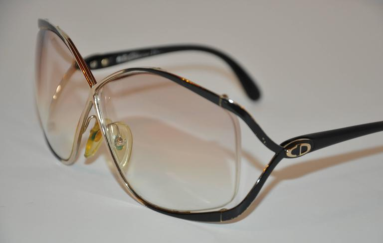 """These wonderfully huge Christian Dior Gilded gold tone hardware with black lucite overlay id accented with the signature """"CD"""" logo on the arms. Slightly prescription lens, the front measures 5 1/2"""" across, height is 2 1/4"""", arms measures 4 3/4"""" in"""