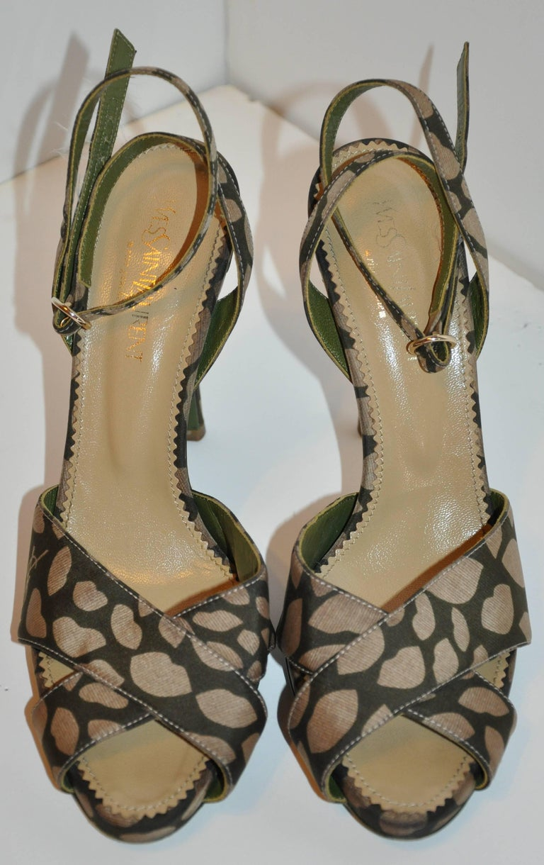Yves Saint Laurent sexy, yet elegant olive Lips & Kisses ankle-strap sandals has adjustable ankle straps accented with a polished gold hardware buckle. slightly platformed in front measuring 1/2 inch in height. The back heel measures 4 1/2