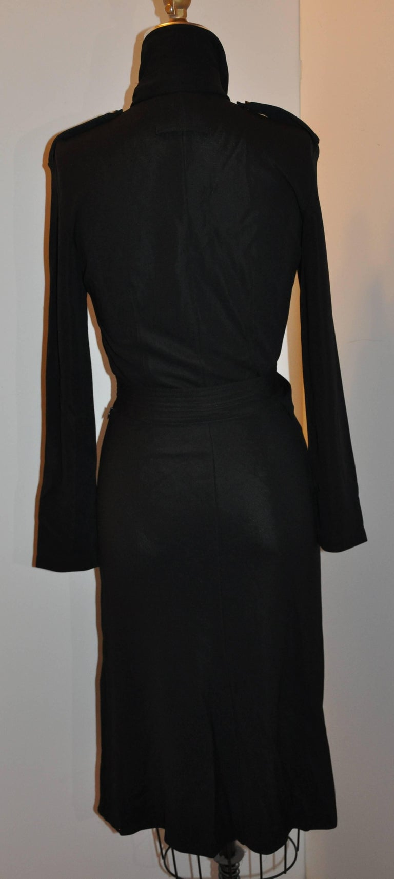 Jean Paul Gaultier wonderfully elegant yet sexy versatile body-hugging black dress has the option of a daytime dress which can be worn right into the evening. The optional matching neck tie as well as the matching belt with buckle give one