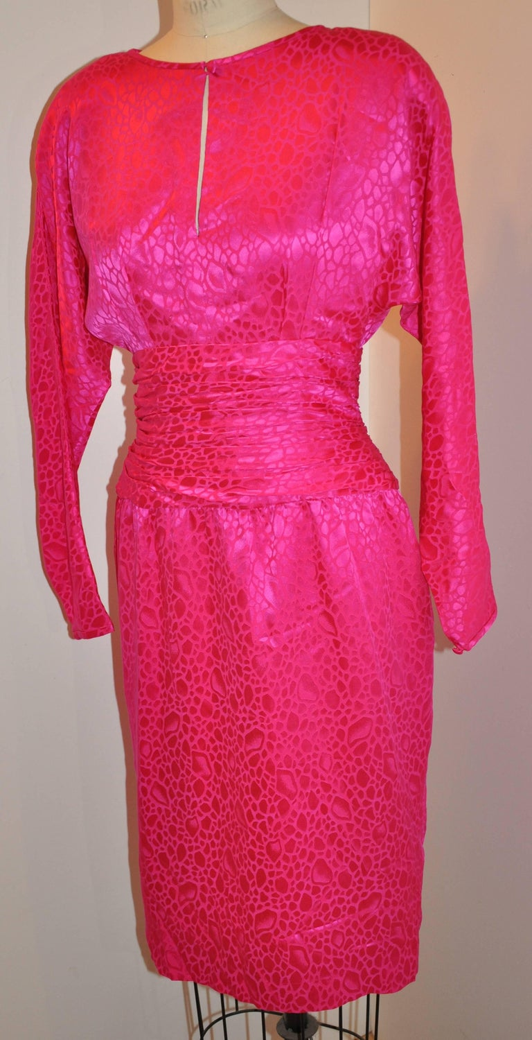 """Flora Kung wonderfully detailed bold fuchsia silk crepe di chine multi-tier train and large bow body-hugging evening cocktail dress has a center back invisible zipper which measures 10 1/2"""". The center back also has a neckline slit"""