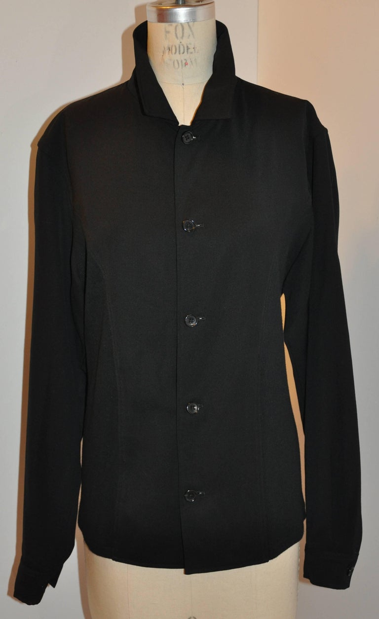 Yohji Yamamoto homme men's black bottom-front jacket is detailed with black micro-ribbed merino wool panel on the sides as well as on the back. The front has five buttons as well as on the sleeve's cuff. Made of 95% cotton with 5% poly