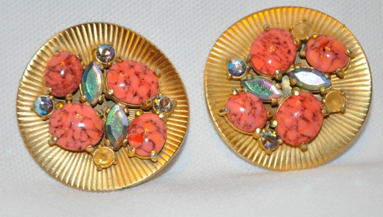 Schiaparelli Wonderful whimsical large textured gilded gold hardware as well as gilded polished gold hardware is accented with multi-colors of faux corals and faux gemstones, both in shapes of round and ovals. The clip-on earrings are missing