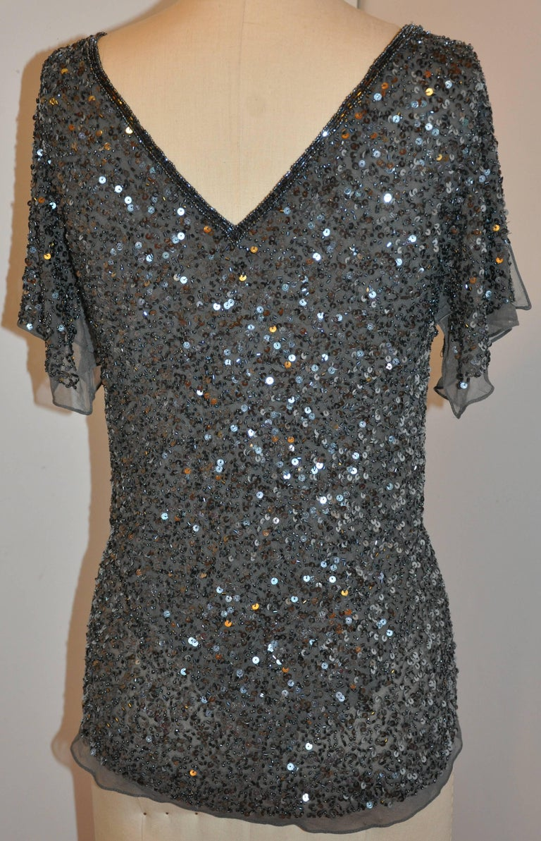 Adrianna Papell elegant charcoal gray silk chiffon hand-beaded micro beaded deep V-neck evening top is accented with softly handkerchief silk chiffon sleeves beaded as well. The sleeves as well as the hemline is finished with one inch of silk