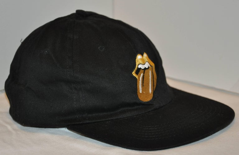 """The Rolling Stones  1997 World-Wide """"Road To Babylon Concert Tour black cotton cap has their signature """"Sticky Tongue"""" in front. The center back has their """"Road To Babylon"""" embroidered, with adjustable straps as well."""