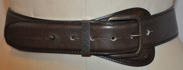 Alaia's wonderful timeless coco brown calfskin leather belt is detailed with brass accents. The leather belt measures 36 inches x 1 1/2 inches. Buckle measures 1 6/8 inches x 2 inches, made in France. There are slight scratches but hardly