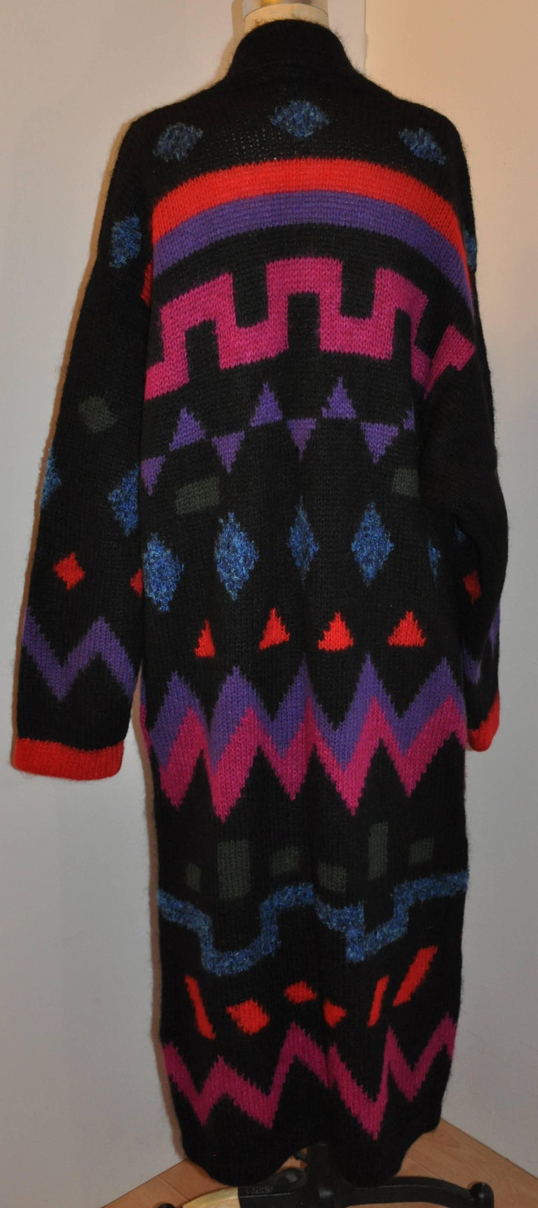 This wonderful bold multi-color and multi-textured abstract maxi woven cardigan coat combined with 45 percent wool, 30 percent acrylic and 25 percent nylon and perfect for those chilly and cozy days. Featuring domain-style sleeves, and a