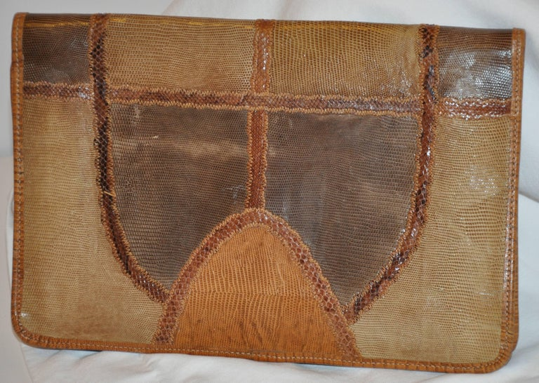 "Carlos Falchi Signature multi ""shades of browns"" multi skins such as snake and lizard makes for a wonderful clutch. The sides are finished with embossed calfskin for better wear and durably well as all finished edges. Top stitching"