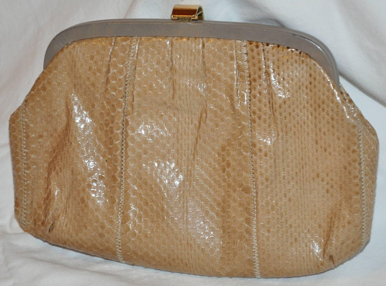 The famed Palizzio of Italy tan snake clutch accented with pale gray calfskin along the top frame as well as the interior measures 9 1/2 inches in length. The height measures 6 1/2 inches, depth is 1 1/2 inches. Optional shoulder straps measures 42