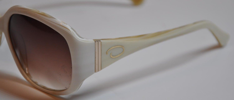 084ac8283e Oscar de la Renta Cream with Multi-Pearl Interior Lucite Sunglasses For Sale  at 1stdibs