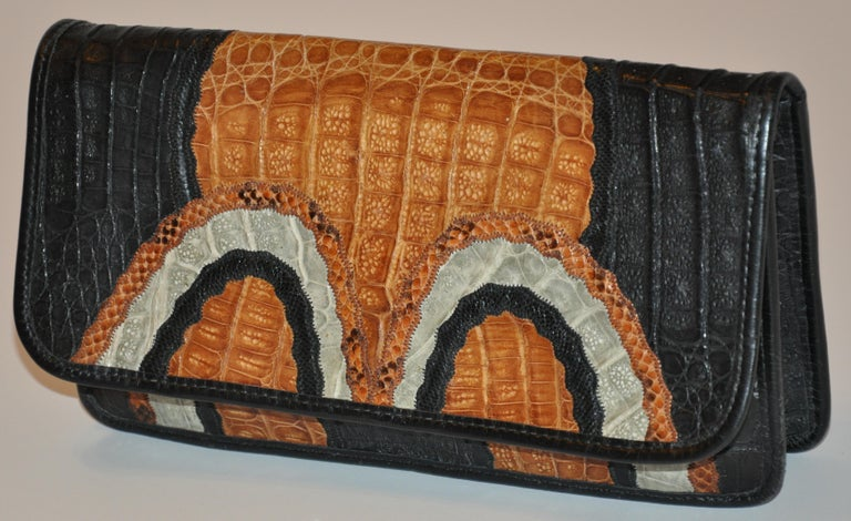 Carlos Falchi wonderfully detailed multi-color clutch and optional shoulder bag accented with Pylon, snake, crocodile and alligator skins into a wonderful