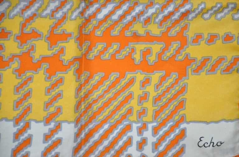 Echo wonderfully whimsical and vividly bold tangerine, ivory, yellow and gray silk scarf with hand-rolled edges, measures 30 inches by 30 inches. Made in Italy.