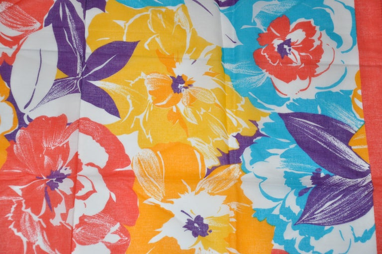 Honey wonderfully bold and vivid multi-color of Multi Florals cotton scarf measures 30 inches by 30 inches, with micro-stitched edges. Made in Italy.