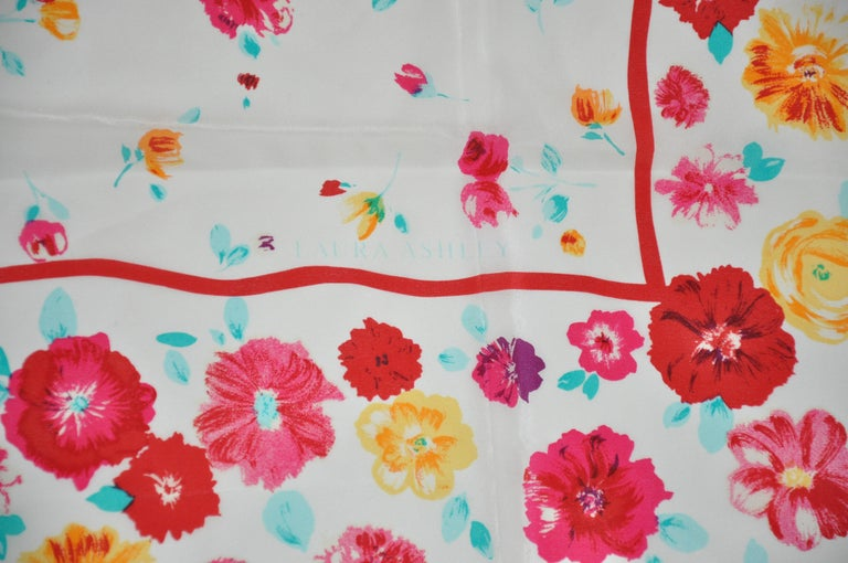 Laura Ashley wonderful Springtime cream with multi florals silk scarf measures 34 1/2 inches by 35 inches, and finished with rolled edges. Made in Japan.