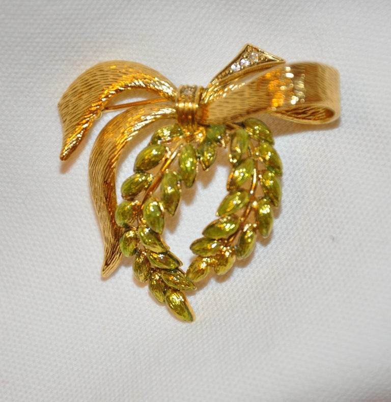 Wonderfully Detailed gilded gold hardware accented with fresh-green enamel