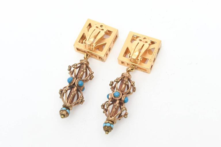 These unusual pair of earrings have a number of great components going on They are signed Varga . Gilt toned metal meets turquoise colored glass in the cage like form They are sculptural and look great on! They look as id they were just designed